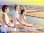 Asian trainer conducts classes of group yoga outdoor