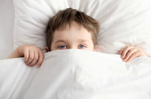 bed-wetting-a-kid-in-bed