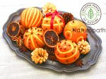 spiced orange pomander balls, scented christmas table decoration
