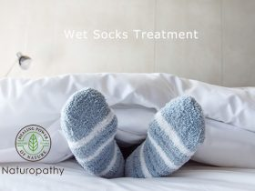 Female foot in warm Stripe wool sock ,Relaxing in bed concept
