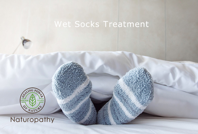 Female foot in warm Stripe wool sock ,Relaxing in bed concept