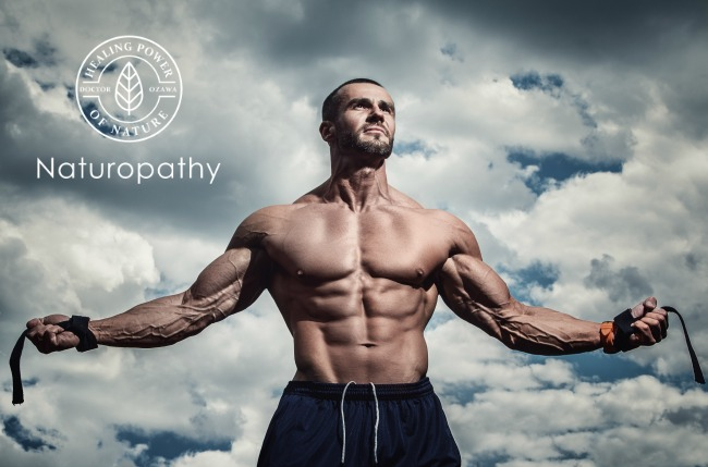 Muscular man posing under cloudy sky