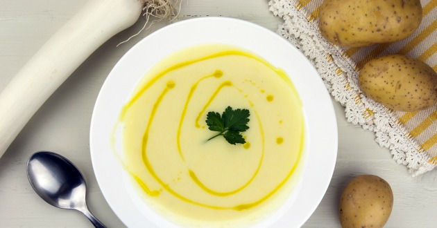 Italian potato and leek soup with olive oil, parsley and croutons
