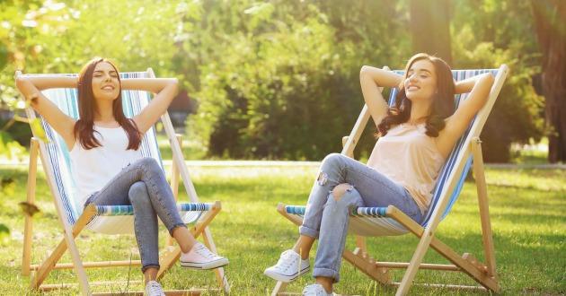 Beautiful young women sunbathing in park