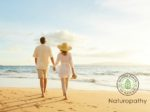 mature couple walking on the beach-eyecatch