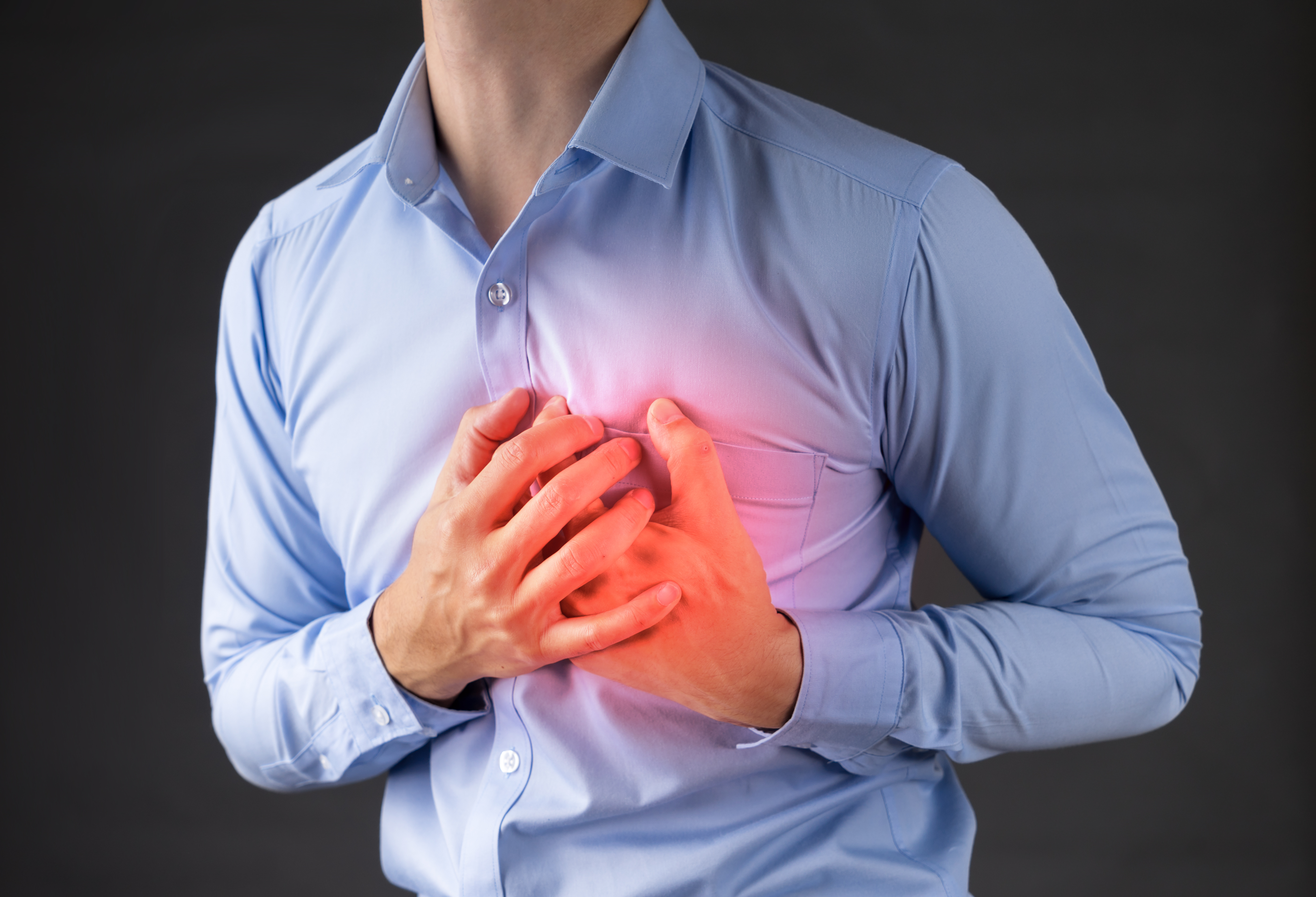 man holding his heart in pain