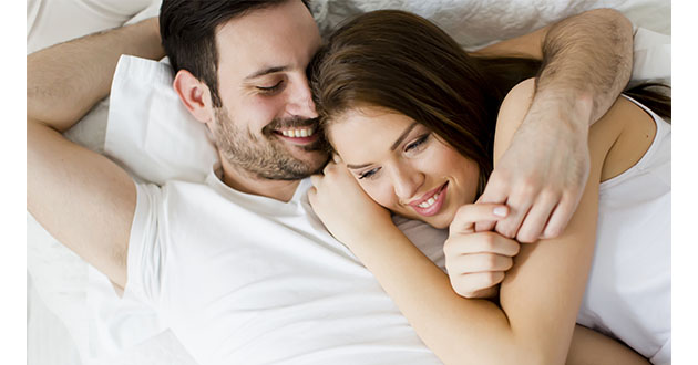 happy couple in bed-630