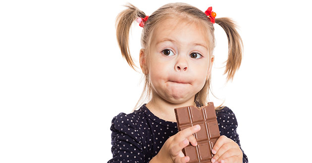 girl eating chocolate-630