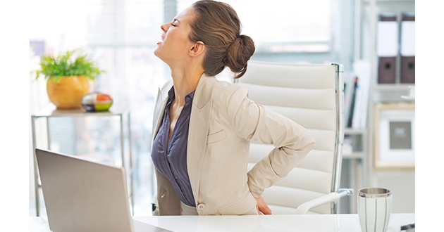 woman back pain in the office-630