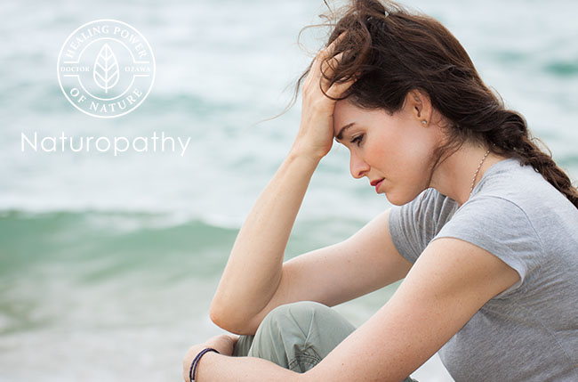 woman depressed at the beach-eyecatch