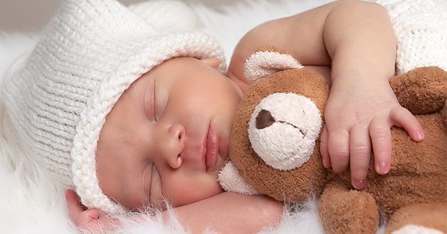 new born baby holding a teddy bear-630