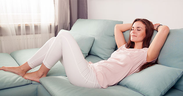 woman relaxing on the couch-630