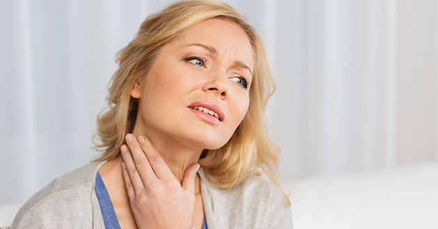 woman touching her throat-thyroid-630