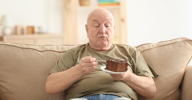 overweight senior eating cake-630