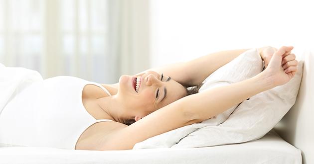 happy woman waking up-630