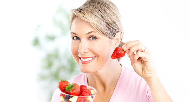 woman eating strawberris-630