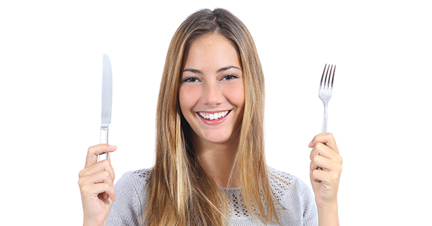 woman holding a knife and a fork-630