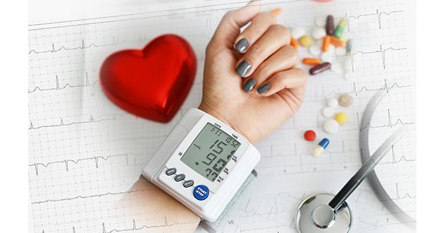 woman monitoring blood pressure-630