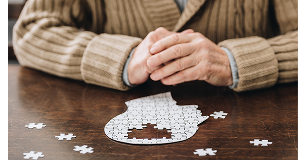 senior man playing puzzle-630